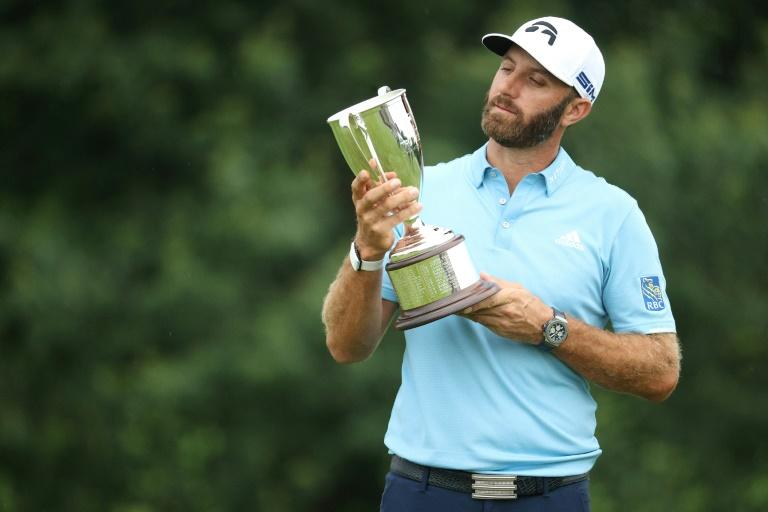 Dustin Johnson with the trophy after winning the Travelers Championship