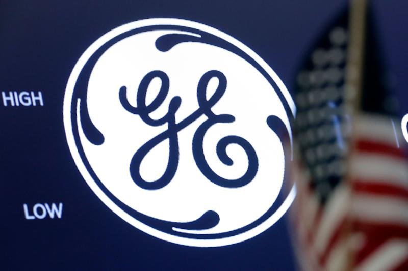 The General Electric logo appears above a trading post on the floor of the New York Stock Exchange, Tuesday, June 26, 2018. General Electric is jumping after it said it will shed its health care business and its majority stake in oil services company Baker Hughes over the next few years. (AP Photo/Richard Drew)