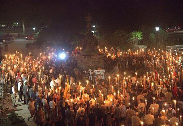 White nationalists carry torches around a statue of Thomas Jefferson on the grounds of the University of Virginia, on the eve of a planned Unite The Right rally. Source: Reuters
