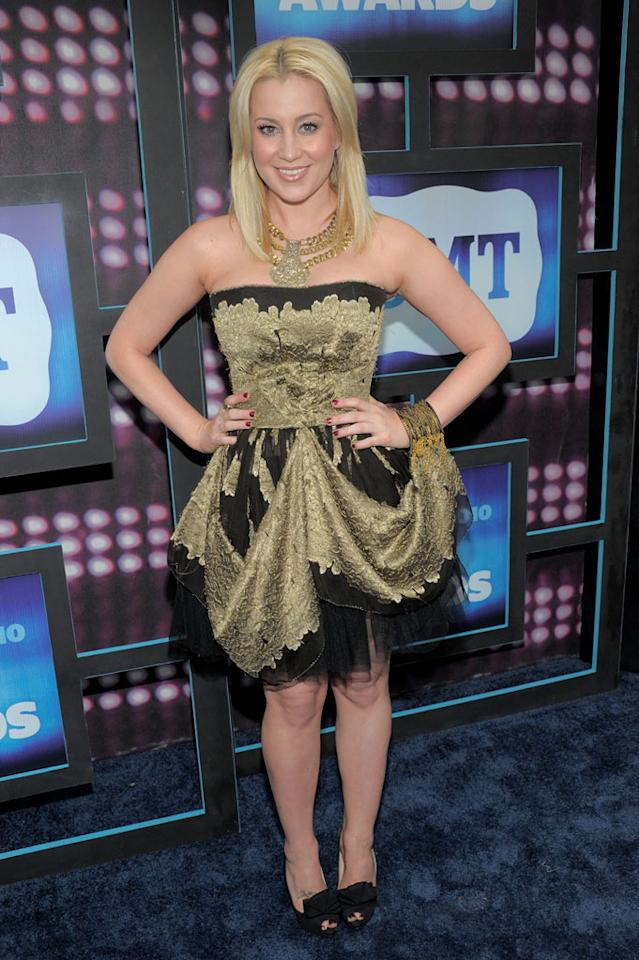 "Former ""Idol"" contestant Kellie Pickler embarrassed herself yet again in a matronly 'do and disastrous dress, which featured an unfortunate color combo, tacky tulle underlay, and bracelet affixed to the hem. Kevin Mazur/<a href=""http://www.wireimage.com"" target=""new"">WireImage.com</a> - June 9, 2010"