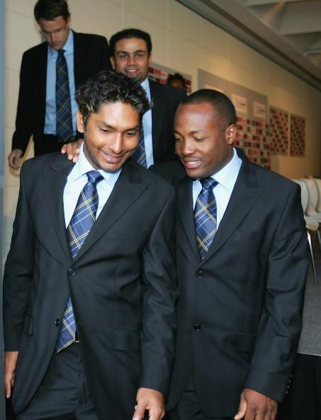 MELBOURNE, AUSTRALIA - OCTOBER 3: Kumar Sangakkara and Brian Lara of the World XI share a joke as they leave a press conference for the ICC Super Series at Federation Square October 3, 2005 in Melbourne, Australia. (Photo by Mark Dadswell/Getty Images)