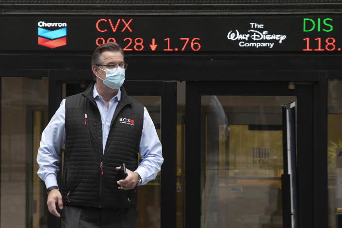 IMAGE DISTRIBUTED FOR THE NEW YORK STOCK EXCHANGE - Trader Steven Capo wears a protective face mask outside the New York Stock Exchange as the trading floor partially reopens on Tuesday, May 26, 2020, in New York. The floor, known worldwide for an anarchic atmosphere with traders shouting orders over one another, has been closed since mid-March due to the coronavirus outbreak. The NYSE says fewer traders will be on the floor at a given time for now in order to support six-feet social distancing requirements. They also must wear masks. (Mark Lennihan/AP Images for the New York Stock Exchange)