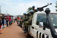 "The United Nations has warned that the flareup in violence in the Central African Republic is the ""early warning signs of genocide,"" and is considering beefing up its 12,000-strong peacekeeping force there (AFP Photo/PATRICK FORT)"