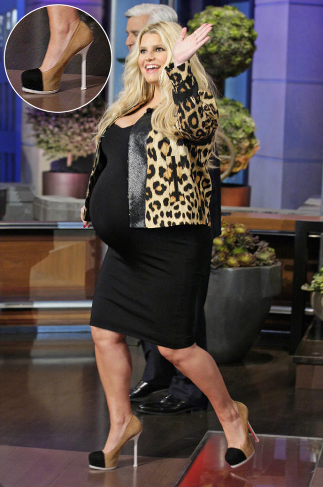 """Jessica Simpson isn't letting her pregnancy get in the way of her chic style. During an appearance on """"<a target=""""_blank"""" href=""""http://ellen.warnerbros.com/2012/03/a_very_pregnant_jessica_simpson_0313.php"""">The Ellen Show</a>,"""" the singer --- who recently admitted she <a target=""""_blank"""" href=""""http://omg.yahoo.com/blogs/celebrity-broods/jessica-simpson-dishes-her-elle-cover-ate-cheesecake-161100803.html"""">weighed 170 lb.</a> when she shot her racy Elle cover --- donned six-inch heels. In a conversation with Jay Leno, Simpson admitted: """"We're waddling at this point. I'm wearing six-inch heels today, and it's a lot of weight to carry on six inches."""""""
