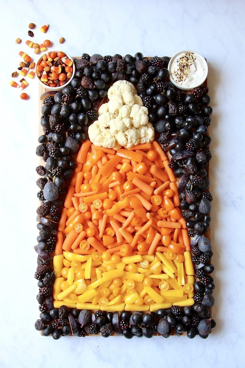 """<p>Kick off a Halloween-themed dinner with a fun and colorful budget-friendly snack board that comes together in just a few minutes, but looks like you spent hours perfecting. </p><p><a class=""""link rapid-noclick-resp"""" href=""""https://thebakermama.com/recipes/candy-corn-snack-board/"""" rel=""""nofollow noopener"""" target=""""_blank"""" data-ylk=""""slk:GET THE RECIPE"""">GET THE RECIPE</a></p>"""