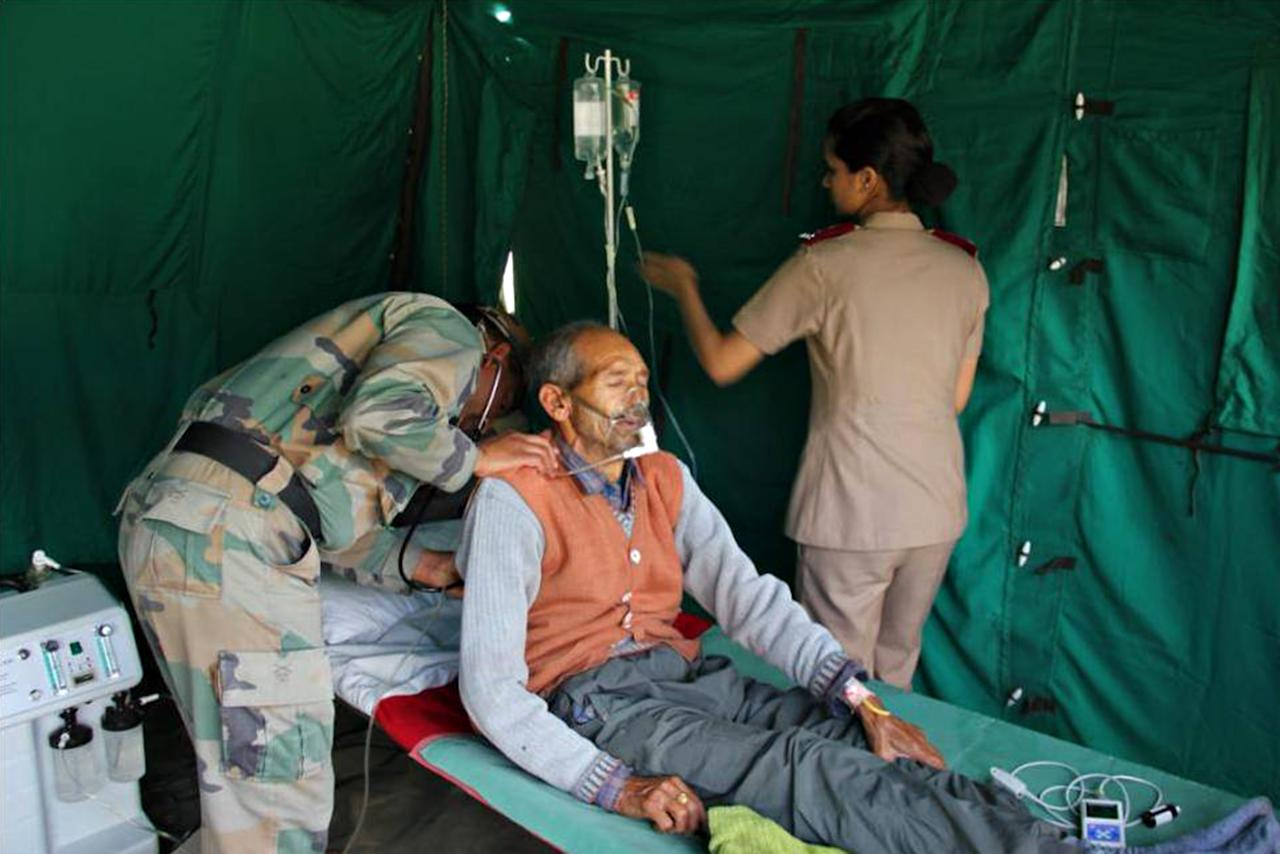 "In this photograph received from the Indian Army on June 20, 2013, members of the Indian Defence Forces tend to a patient at a field hospital following flash floods in the northern Uttarakhand state. India's military battled on June 20 to reach villages and towns cut off by flash floods and landslides in the country's north as officials warned at least 1,000 people may have been killed. AFP PHOTO/INDIAN ARMY   ----EDITORS NOTE---- RESTRICTED TO EDITORIAL USE - MANDATORY CREDIT -  ""AFP PHOTO/INDIAN ARMY"" - NO MARKETING NO ADVERTISING CAMPAIGNS - DISTRIBUTED AS A SERVICE TO CLIENTS -----"