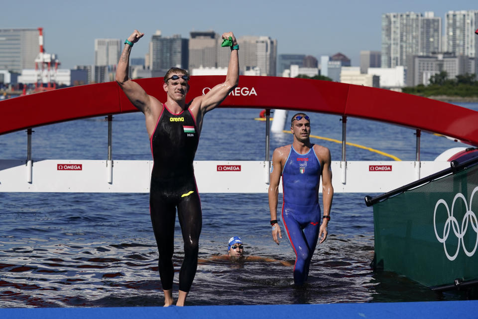 Silver medalist Kristof Rasovszky, left, of Hungary, bronze medalist Gregorio Paltrinieri, of Italy, walks out of the water after the men's marathon swimming event at the 2020 Summer Olympics, Thursday, Aug. 5, 2021, in Tokyo, Japan. (AP Photo/Jae C. Hong)