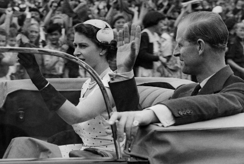Queen Elizabeth II and Prince Philip return from a youth rally in Auckland, New Zealand, during the coronation world tour on Dec. 24, 1953.