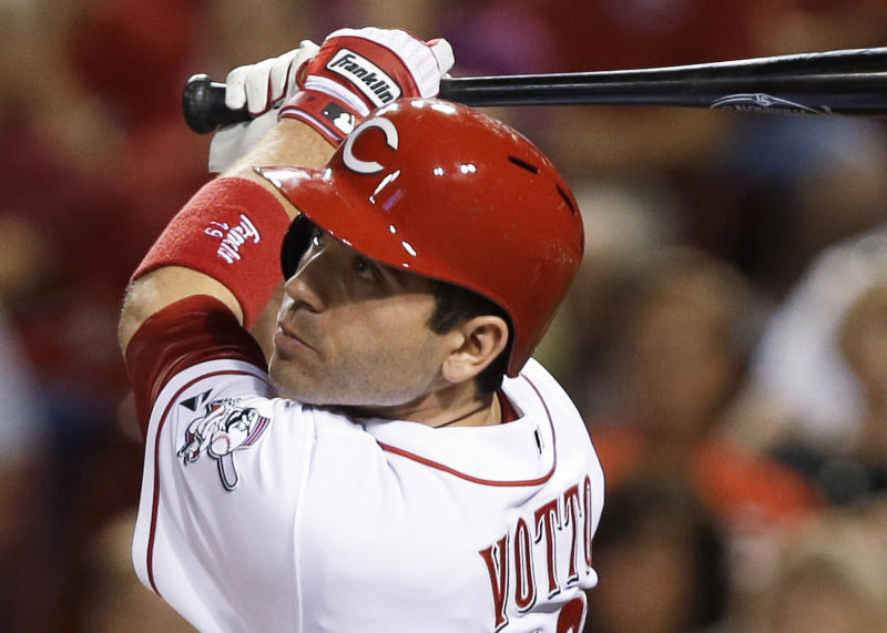 Cincinnati Reds' Joey Votto watches his two-run home run off Los Angeles Dodgers relief pitcher J.P. Howell in the fifth inning of a baseball game, Friday, Sept. 6, 2013, in Cincinnati. (AP Photo/Al Behrman)