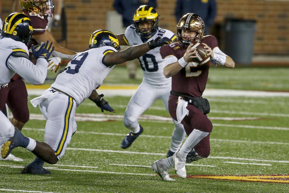 Michigan defensive lineman Kwity Paye (19) getting one of his two sacks aaginst Minnesota on Saturday. (AP Photo/Bruce Kluckhohn)