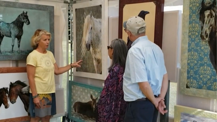 Wildlife photographer Mary Hone shows off her work. / Credit: CBS News