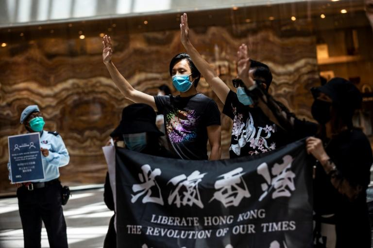 Semi-autonomous Hong Kong has been rocked by months of huge pro-democracy protests (AFP Photo/ISAAC LAWRENCE)