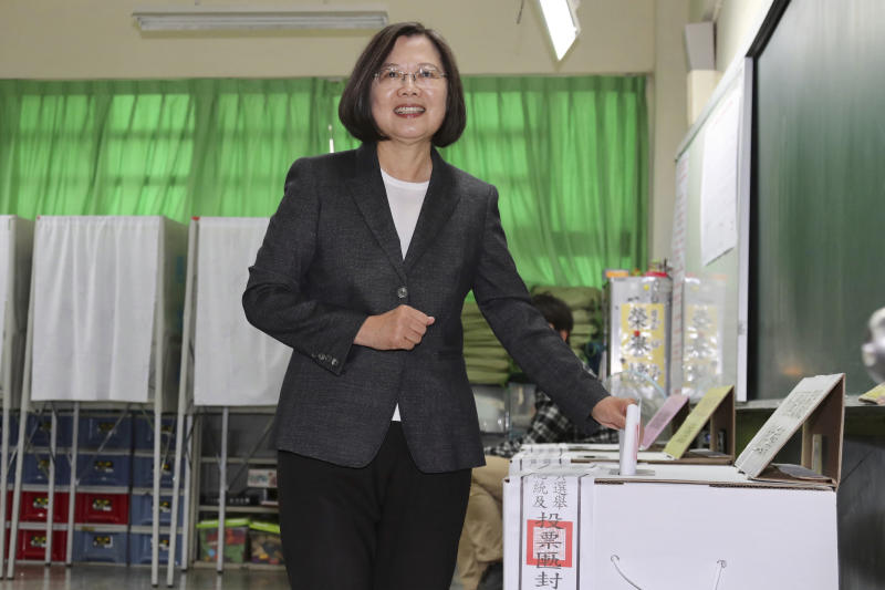 Taiwanese President and presidential election candidate Tsai Ing-wen casts her ballot at a polling station in New Taipei City, Taiwan, Saturday, Jan. 11, 2020. The future of Taiwan's democracy is on the line as the self-ruled island's 19 million voters decide on whether to give independence-leaning President Tsai Ing-wen a second term. (Chang Hao-an/Pool Photo via AP)