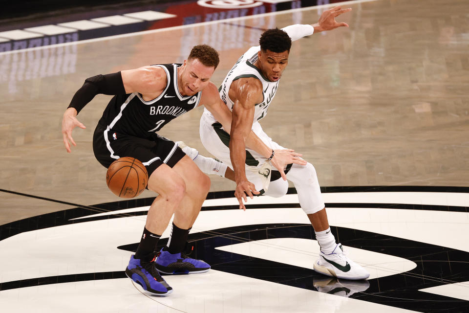 NEW YORK, NEW YORK - JUNE 05: Giannis Antetokounmpo #34 of the Milwaukee Bucks steals the ball from Blake Griffin #2 of the Brooklyn Nets during the first quarter during Game One of the Eastern Conference second round series at Barclays Center on June 05, 2021 in New York City. NOTE TO USER: User expressly acknowledges and agrees that, by downloading and or using this photograph, User is consenting to the terms and conditions of the Getty Images License Agreement. (Photo by Tim Nwachukwu/Getty Images)