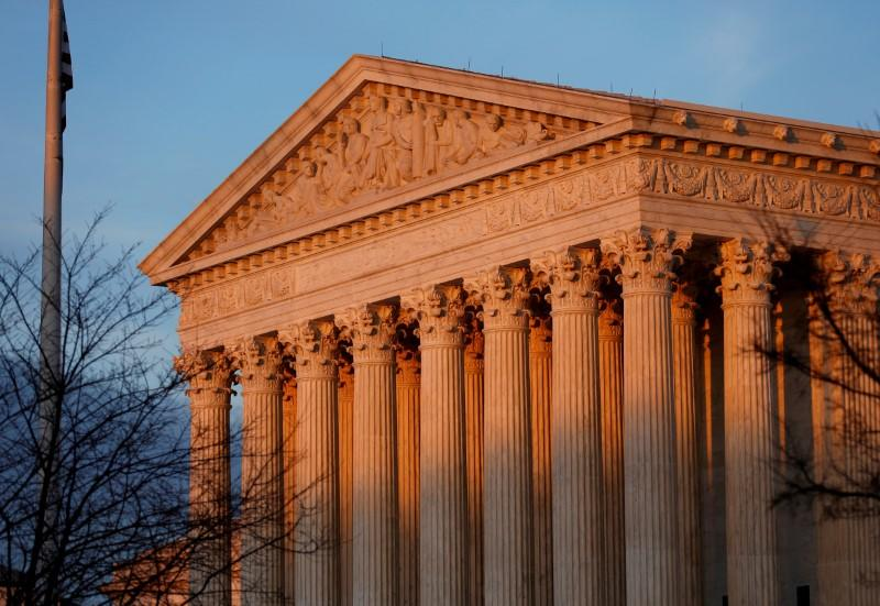 FILE PHOTO: Light from the setting sun shines on the Supreme Court in Washington