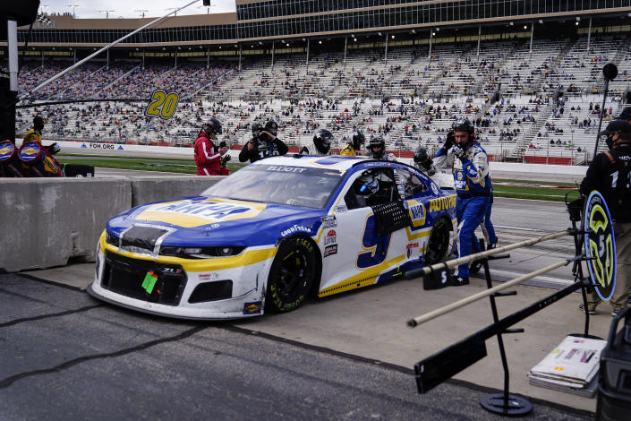 NASCAR Cup Series driver Chase Elliott leaves the track ending his race after smoke was seeming coming from his car during a NASCAR Cup Series at Atlanta Motor Speedway on Sunday, March 21, 2021, in Hampton, Ga. (AP Photo/Brynn Anderson)