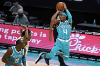 Charlotte Hornets guard Devonte' Graham looks to pass the ball during the first half of the team's NBA basketball game against the Dallas Mavericks in Charlotte, N.C., Wednesday, Jan. 13, 2021. (AP Photo/Chris Carlson)