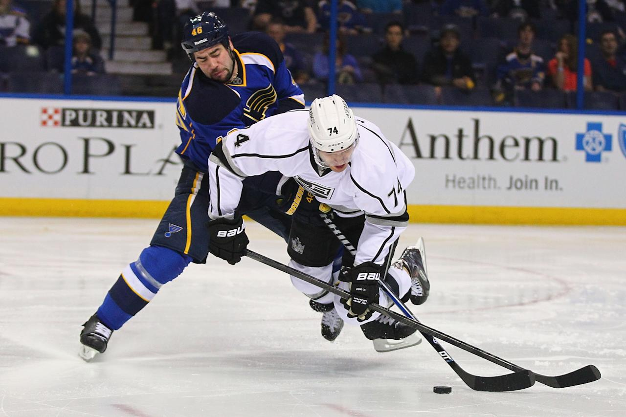ST. LOUIS, MO - APRIL 30: Roman Polak #46 of the St. Louis Blues trips up Dwight King #74 of the Los Angeles Kings in Game One of the Western Conference Quarterfinals during the 2013 NHL Stanley Cup Playoffs at the Scottrade Center on April 30, 2013 in St. Louis, Missouri.  (Photo by Dilip Vishwanat/Getty Images)