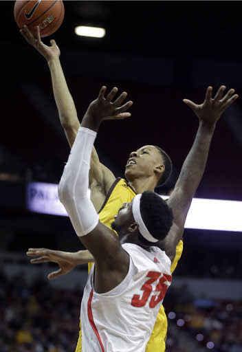 Wyoming's Brandon Porter shoots over New Mexico's Carlton Bragg during the first half of an NCAA college basketball game in the Mountain West Conference tournament Wednesday, March 13, 2019, in Las Vegas. (AP Photo/Isaac Brekken)