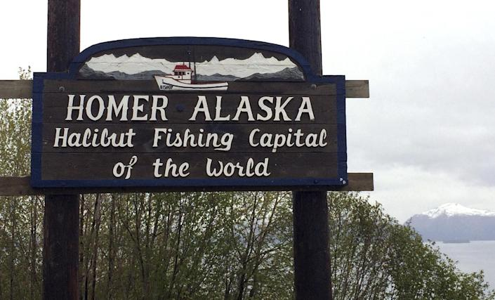 """In this May 23, 2015, photo the welcome sign is displayed on the outskirts of Homer, Alaska. The fishing town is the latest U.S. city to consider affirming its commitment to inclusion amid national concerns about the treatment of immigrants, religious minorities and others. Homer city leaders are expected to weigh a resolution Monday, Feb. 27, 2017, that says Homer will resist any efforts to profile """"vulnerable populations."""" (AP Photo/Mark Thiessen)"""