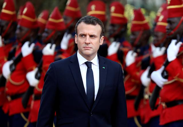 French President Emmanuel Macron reviews troops during a ceremony at the presidential palace before a meeting with Senegalese President in Dakar, Senegal, February 2, 2018. REUTERS/Ludovic Marin/Pool