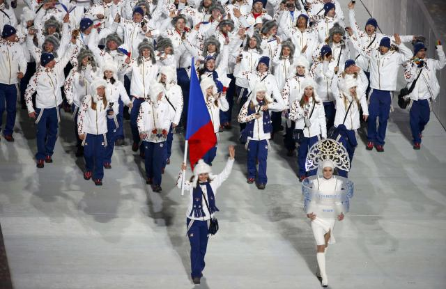 Flag-bearer Sarka Strachova of the Czech Republic leads her country's contingent during the athletes' parade at the opening ceremony of the 2014 Sochi Winter Olympics, February 7, 2014. REUTERS/Lucy Nicholson (RUSSIA - Tags: OLYMPICS SPORT)