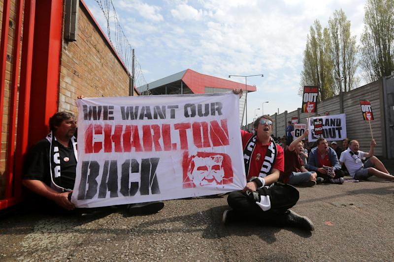 Listen up: Fans have waged a long campaign against Roland Duchatelet but his exit from Charlton has been delayed by protracted takeover talks: Getty Images