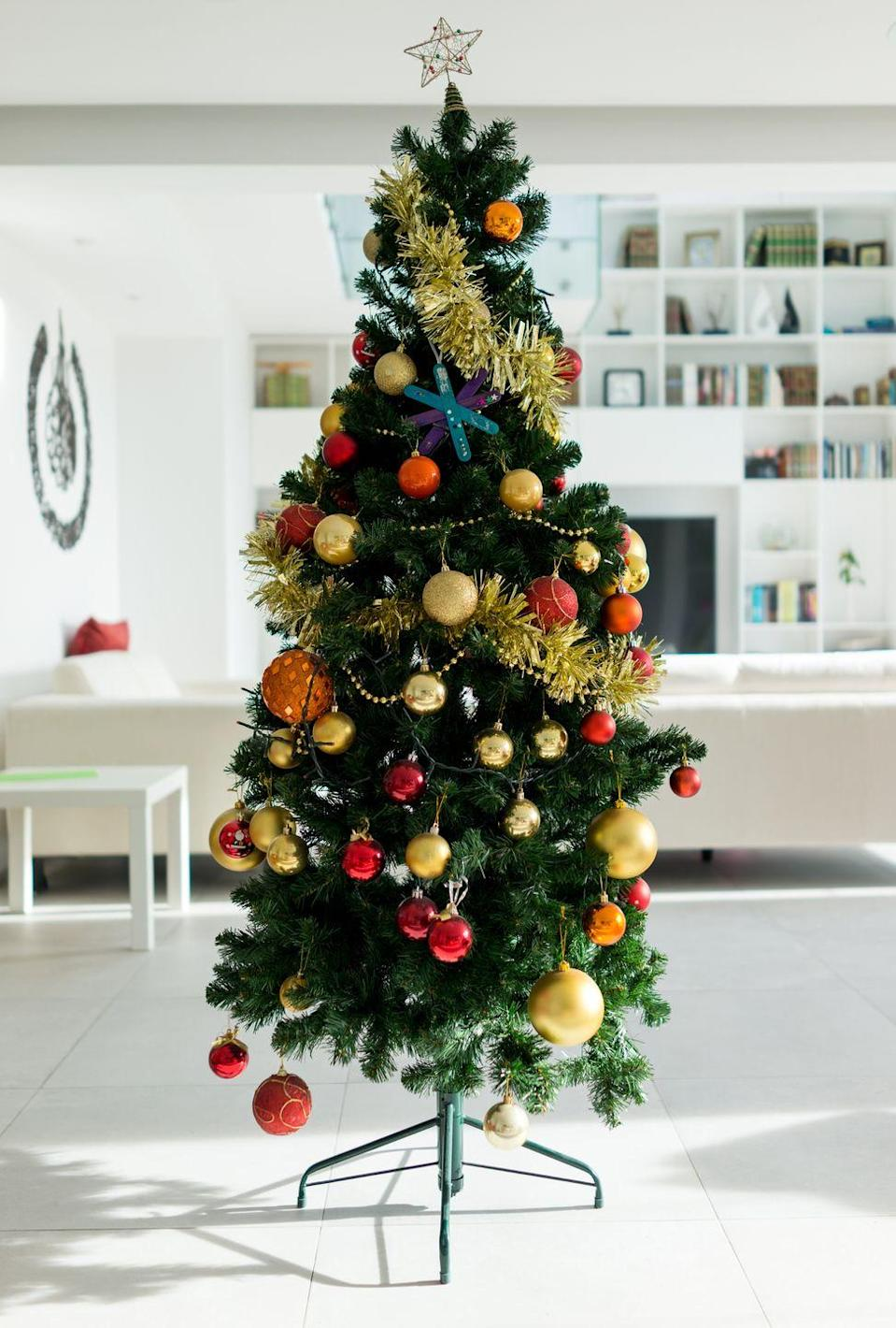 <p>It may be cold outside, but your holiday decor doesn't have to be. A Christmas tree like this that uses only warm colors makes a bright, vibrant statement in any kind of weather. </p>