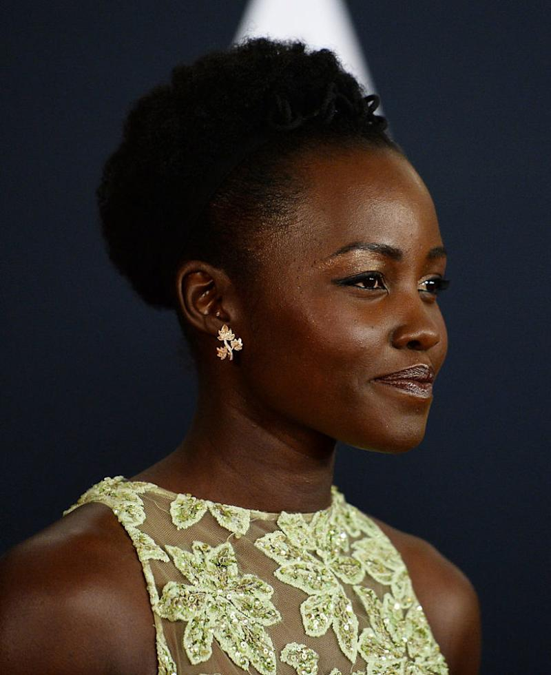 Lupita Nyong'o's golden leaves dress glamorously melds fall and winter fashion, and we're in love