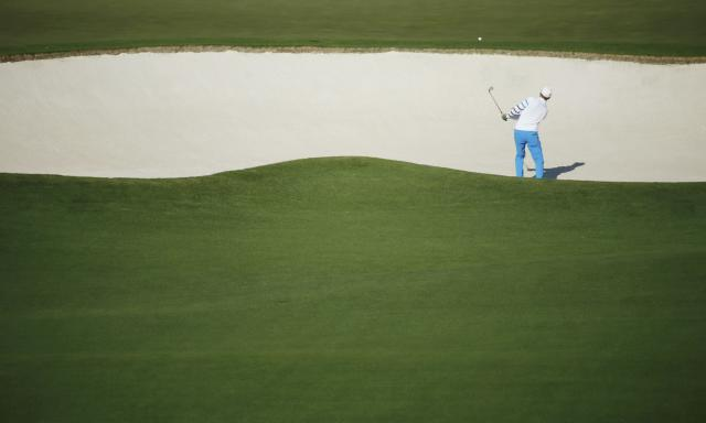 Sweden's Jonas Blixt hits from the sand on the fourth hole during the first round of the Masters golf tournament at the Augusta National Golf Club in Augusta, Georgia April 10, 2014. REUTERS/Mike Blake (UNITED STATES - Tags: SPORT GOLF)