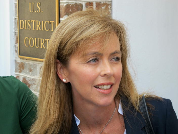 FILE - In this April 29, 2016, file photo, attorney Debbie Barbier speaks to reporters outside the federal courthouse in Charleston, S.C. Barbier had been hired to join Butch Bowers in crafting a defense for former President Donald Trump's unprecedented second impeachment trial, set for the week of Feb. 8, 2021. (AP Photo/Bruce Smith, File)