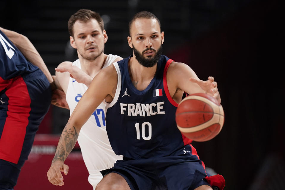 France's France Evan Fournier (10) is defended by Czech Republic's Jaromir Bohacik (17) during a men's basketball preliminary round game at the 2020 Summer Olympics in Saitama, Japan, Wednesday, July 28, 2021. (AP Photo/Charlie Neibergall)