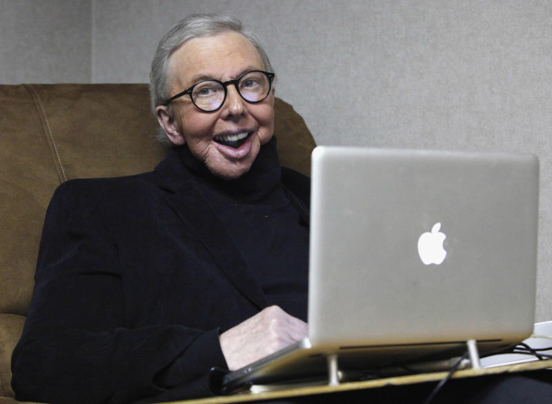 FILE - In this Jan. 12, 2011 file photo, Pulitzer Prize-winning movie critic Roger Ebert works in his office at the WTTW-TV studios in Chicago. In an essay posted Tuesday, April 2, 2013, Ebert says that he has cancer again and is scaling back his movie reviews while undergoing radiation. The veteran critic has previously battled cancer in his thyroid and salivary glands and lost the ability to speak and eat after surgery.  (AP Photo/Charles Rex Arbogast, File)