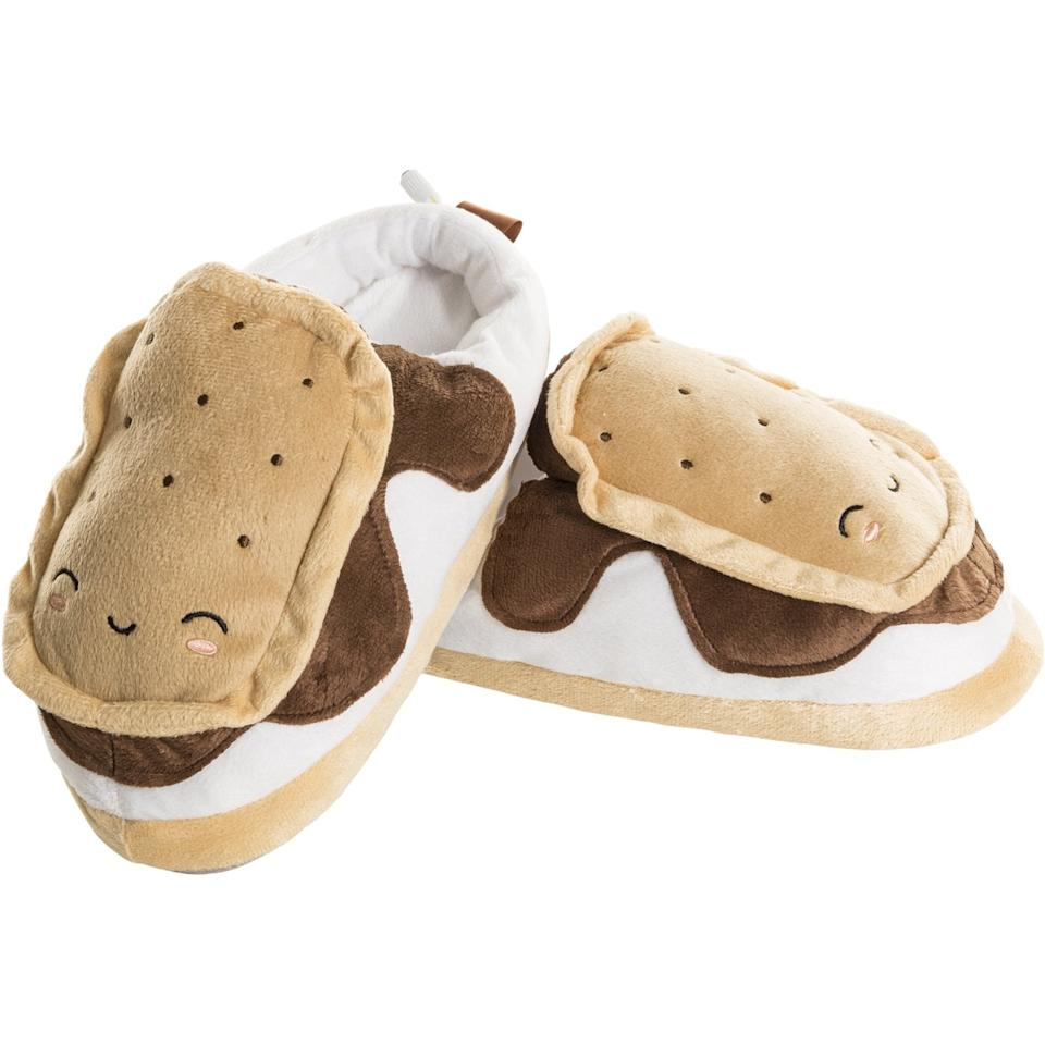 "<p>These <a href=""https://www.popsugar.com/buy/Smoko-Heated-Smores-Slippers-USB-Electric-Heating-489961?p_name=Smoko%20Heated%20Smores%20Slippers%20With%20USB%20Electric%20Heating&retailer=amazon.com&pid=489961&price=28&evar1=tres%3Aus&evar9=45180102&evar98=https%3A%2F%2Fwww.popsugar.com%2Flove%2Fphoto-gallery%2F45180102%2Fimage%2F45180118%2FSmoko-Heated-Smores-Slippers-USB-Electric-Heating&list1=shopping%2Cfall%2Chome%20decor%2Coffice%2Cwinter%2Coffice%20products%2Chome%20shopping&prop13=api&pdata=1"" rel=""nofollow"" data-shoppable-link=""1"" target=""_blank"" class=""ga-track"" data-ga-category=""Related"" data-ga-label=""https://www.amazon.com/Calming-Covers-Heated-Slipper-tootsies/dp/B07Q3SPQRL/"" data-ga-action=""In-Line Links"">Smoko Heated Smores Slippers With USB Electric Heating</a> ($28) are extraplush and extrawarm! </p>"