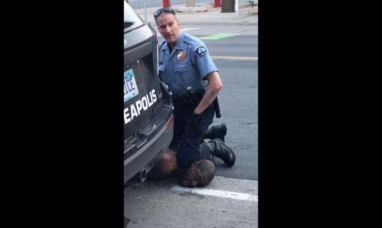 A bystander video of a Minneapolis police officer holding his knee to George Floyd's neck has gone viral