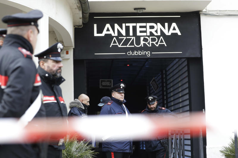 Carabinieri officers stand in front of the disco 'Lanterna Azzurra' in Corinaldo, central Italy, Saturday, Dec. 8, 2018. A stampede at a rap concert in an overcrowded disco in central Italy killed five young teenagers and a woman who had accompanied her daughter to the event early Saturday, police said, adding that 59 people were injured. (AP Photo/Andrew Medichini)