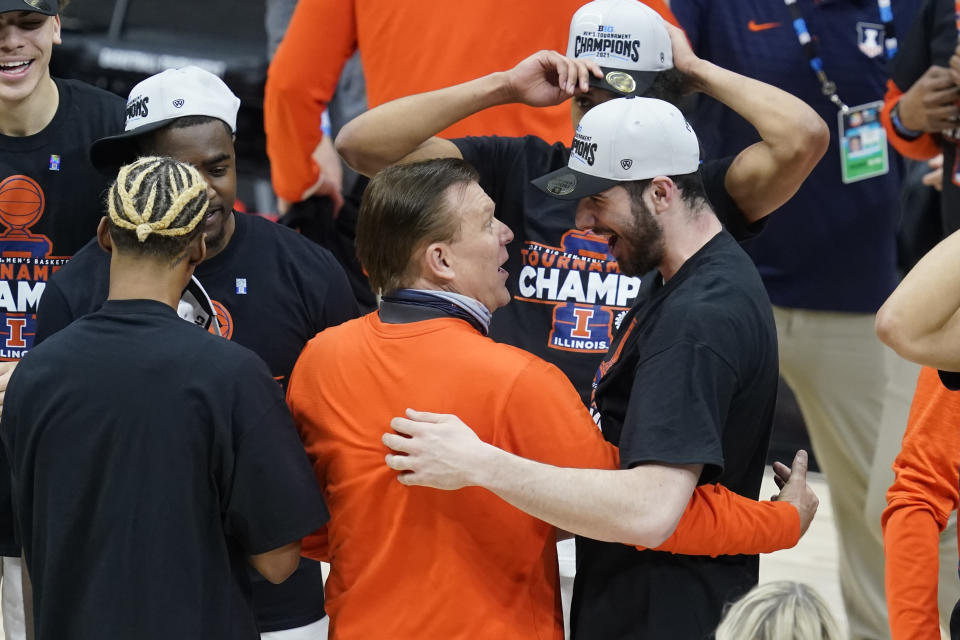 Illinois head coach Brad Underwood hugs Giorgi Bezhanishvili as they celebrate after Illinois defeated Ohio State in overtime of an NCAA college basketball championship game at the Big Ten Conference tournament, Sunday, March 14, 2021, in Indianapolis. Illinois won in overtime. (AP Photo/Darron Cummings)