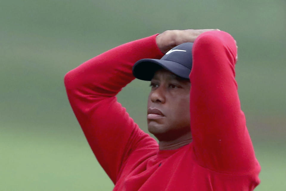 Tiger Woods reacts after his shot on the second hole during the final round of the Masters golf tournament Sunday, Nov. 15, 2020, in Augusta, Ga. (Curtis Compton/Atlanta Journal-Constitution via AP)