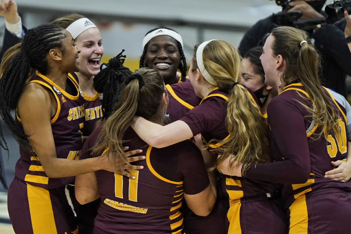 Central Michigan players celebrate after defeating Bowling Green 77-72 in an NCAA college basketball game in the championship of the Mid-American Conference tournament, Saturday, March 13, 2021, in Cleveland. (AP Photo/Tony Dejak)