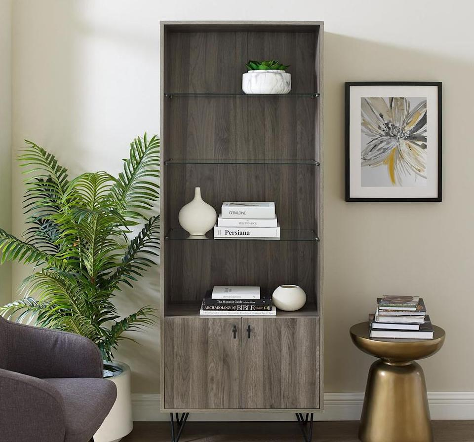 """Featuring glass shelves and doors for anything you want to tuck away, this cabinet has tons of storage for vases, books and trinkets from trips. You can also use it for dinnerware, if you need the extra room.<a href=""""https://fave.co/3ohQCIq"""" target=""""_blank"""" rel=""""noopener noreferrer"""">Originally $227, get it now for $176 at The Home Depot</a>."""