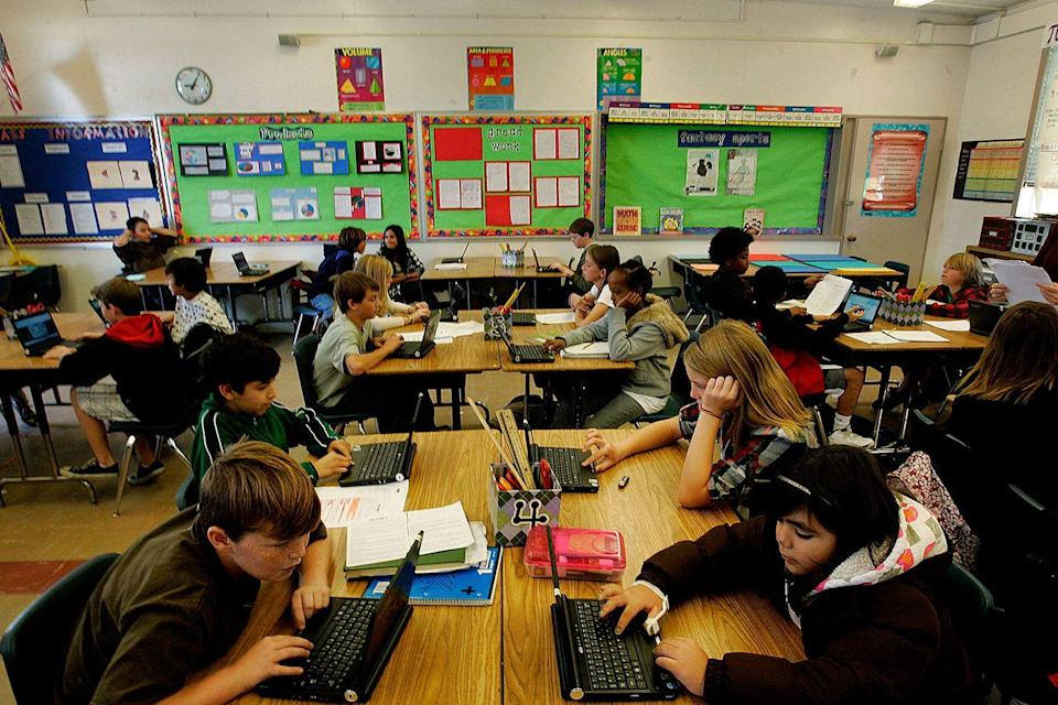 <p>Sixth grade students in San Diego use their laptops to work on some problems during algebra. </p>