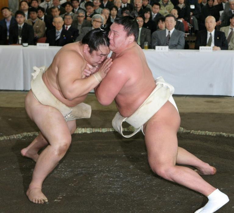 Hakuho's father was a champion Mongolian wrestler who won his country's first Olympic medal at the 1968 Games (AFP/STR)