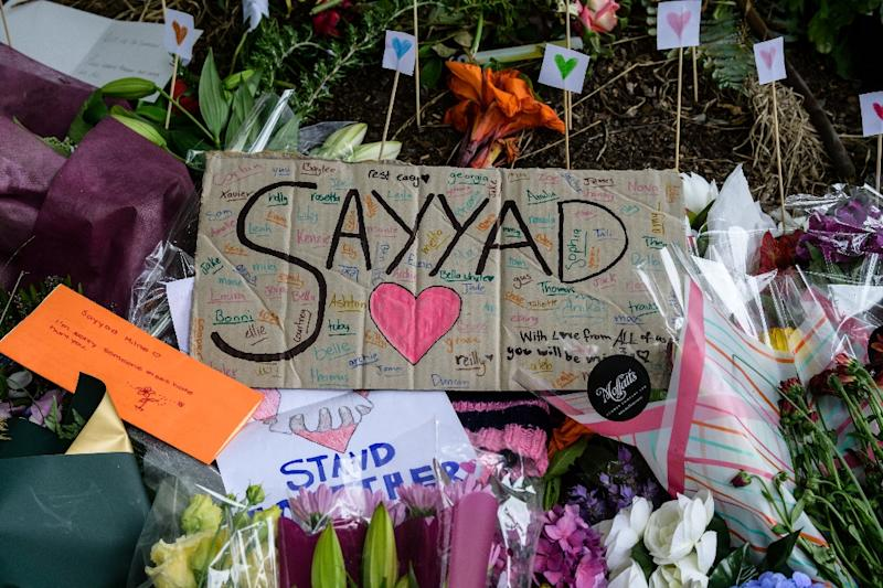Among tributes to victims was a hand-written sign for 14-year-old Sayyad Milne (AFP Photo/ANTHONY WALLACE)