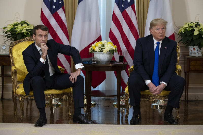 President Donald Trump meets President Emmanuel Macron at Winfield House during the NATO summit, Tuesday, Dec. 3, 2019, in London. (AP Photo/ Evan Vucci)