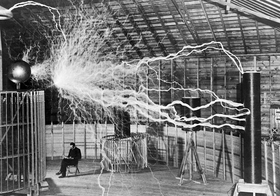 <p>Nikola Tesla, with his equipment for producing high-frequency alternating currents</p> (Wellcome Collection/CC BY 4.0)