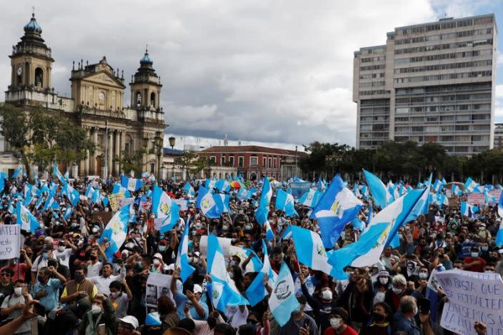 Demonstrators take part in a protest demanding the resignation of President Alejandro Giammattei, in Guatemala City