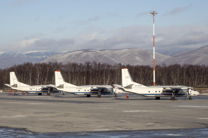 The Antonov An-26 with the same board number #RA-26085 as the missed plane is parked between two other Antonov An-26 planes at Airport Elizovo outside Petropavlovsk-Kamchatsky, Russia, Tuesday, Nov. 17, 2020.Local officials say a plane with 28 people on board has gone missing in the Russian Far East region of Kamchatka. Emergency officials say the Antonov An-26 plane with 22 passengers and six crew members missed a scheduled communication while it was flying Tuesday from the city of Petropavlovsk-Kamchatsky to the village of Palana. (AP Photo/Marina Lystseva)