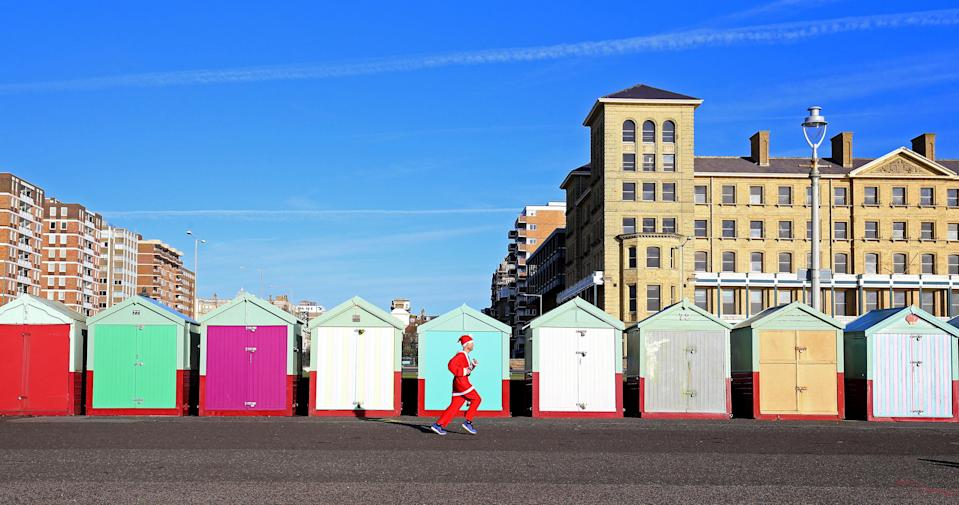 <p>A competitor takes part in the annual Santa Dash along the promenade in Brighton, East Sussex to raise money for the Rockinghorse charity to help children across Sussex. (PA) </p>