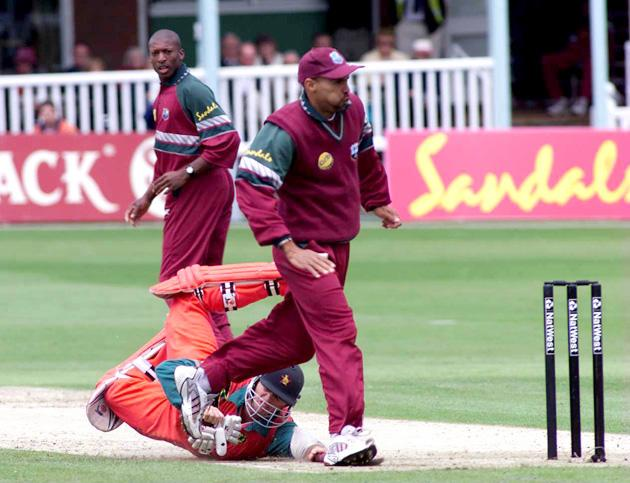 11 Jul 2000:  Guy Whitall of Zimbabwe gets in a tangle with Jimmy Adams of the West Indies during the Nat West Series One Day International match between Zimbabwe and the West Indies at the St Lawrence ground in Cantebury. Mandatory Credit: Laurence Griffiths/ALLSPORT