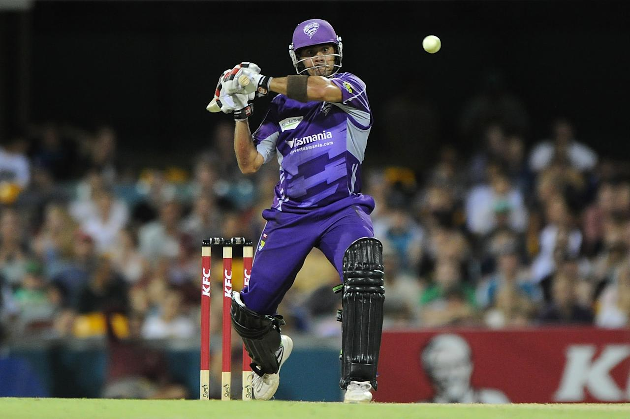 BRISBANE, AUSTRALIA - DECEMBER 09:  Owais Shah of the Hurricanes bats during the Big Bash League match between the Brisbane Heat and the Hobart Hurricanes at The Gabba on December 9, 2012 in Brisbane, Australia.  (Photo by Matt Roberts/Getty Images)